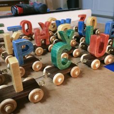 a wooden letter train that kids can play with and learn at the same time!