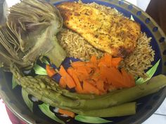 Broiled Salmon with a mustard, honey and olive oil glaze, turned out great! Set it on a bed of rice and plated along with steamed artichoke, carrots and asparagus