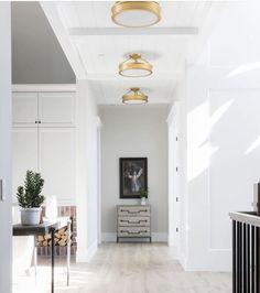 Dreamy hallway for this home.   #LightingDesign #lighting #goldfixtures #onlineshopping #woodfloors #whitewalls #neutrals #hallway #homedecor #interiordesign #newhome