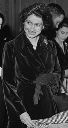 November Queen Elizabeth II (front, centre) and Princess Margaret (behind, just seen) inspect garments with Lady Kenneth Clark (left) at a fashion show by the Incorporated Society of London Fashion Designers at Claridges Hotel in London, November British Monarchy History, November 12th, Hm The Queen, Princess Margaret, Queen Elizabeth Ii, London Fashion, Fashion Designers, Royals, Centre
