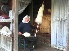 Lady spinning wool with a distaff in Breb Romania - different technique; great distaff.