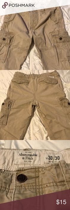 Boys Abercrombie & Fitch cargo pants Tan Abercrombie & Fitch boys cargo pants. They have a draw string for the best fit and button fly (see pic). Abercrombie & Fitch Bottoms