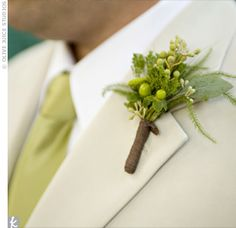 The guys' berry and seeded eucalyptus boutonnieres matched their ties and added an organic touch to their crisp look.