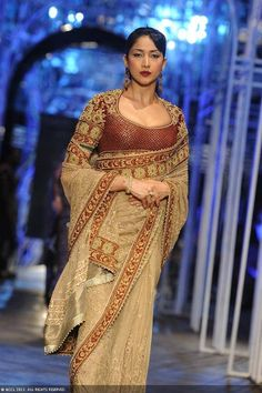 A model walks the ramp for designer Tarun Tahiliani during the Grand Finale of the India Bridal Fashion Week (IBFW) 2013, held in New Delhi.