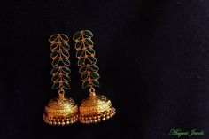 Emerald-studded Chandelier with Gold-plated Silver Jhumka.