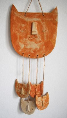Ceramic sleeping cat and kittens wall hanging mobile.