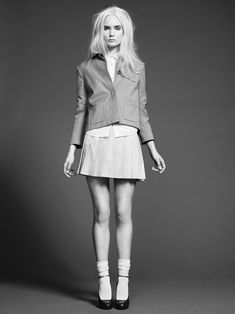Beige cropped cotton jacket J Lindeberg, Light blue pleated cotton dress Island of Your Own, White cotton shirt Acne, Knee high cotton socks Falke, Brown leather shoes stylist's own.