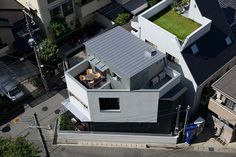 H.ARCHITECTS designs triangular house opposite lush park in japan