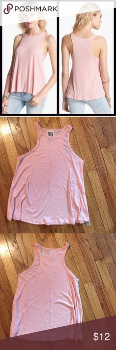 NWOT Free People Long Beach Ribbed Tank Top Round neckline, racer back, & pullover style * Subtly flared swing silhouette * Super soft & lightweight ribbed fabric; Relaxed fit, Color: Petal Pink ; 65% polyester & 35% rayon, machine wash Item. Brand new, doesn't have tags attached, but still has the cut off before wearing tag attached, perfect condition. Free People Tops Tank Tops