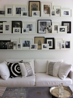 Gallery Wall. Love this - the picture frames don't have to match or be in any particular order so they are easy to change and move around! Plus - to nails or hammers needed!