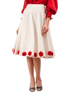 Riddhi and Revika present to you the summer's pick - a classy white skirt. The box pleats and the red flowers around the hem are a sure add to your image of a pretty girl from next door do. Wear it with a red balloon top and a pair of peep toe pumps and get ready to party!