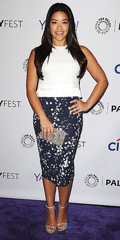 Love Her Outfit! Star Style to Steal | GINA RODRIGUEZ | Pencil skirts can also be flirty, as seen on the Jane the Virgin star, who pairs her scatter-print navy number with a structured white crop top and silver Stuart Weitzman heels and an Edie Parker clutch.