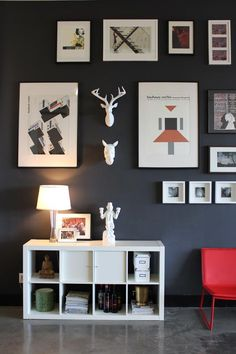 Black, white and red against a dark gray wall in a Los Angeles loft