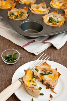 Lasagna Cups (#quick #lasagna by Pepper.ph)  11/2 cups part skim ricotta cheese   24 small square wonton wrappers   11/2 cups shredded mozzarella cheese   11/2 cups shredded sharp cheddar cheese   1 tsp chopped basil   1 tsp chopped oregano   commercial Spaghetti sauce
