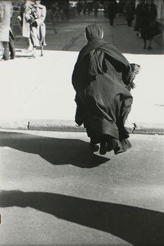 Saul Leiter, Nun Running Across Street, date unknown