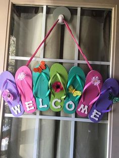 Get sandals from the dollar store, glue them together as shown, add WELCOME letters and other embellishments, then hang it as a summer wreath. Love this easy DIY wreath idea
