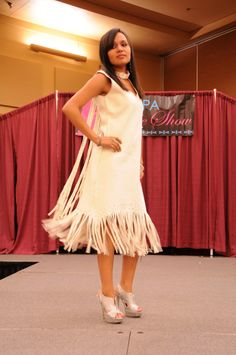Native American Buckskin Dress | ... with peacock feathers. Right: White buckskin wedding dress