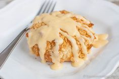 Chicken Pillows- shredded chicken mixed with cream cheese and butter, stuffed in a  crescent roll pillow topped with crushed ritz crackers and an easy cheese sauce.