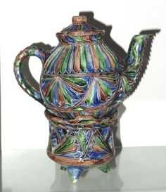 Miniature teapot with tea light holder