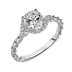 Wow, this engagement ring is beautiful. I love how it looks twisted because it reminds me of rope. I wonder what size of diamond this is? It seems like a pretty good sized one.