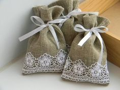 Burlap & Lace Bags! Bay, I could make these and you could put wedding favors or something in them.