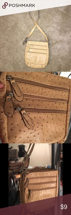 Tan leather purse Tan leather purse with zipper detail New and never carried. Bags Satchels