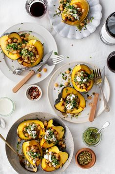 Acorn Squash stuffed with Chickpeas & Chimichurri is the best vegetarian Thanksgiving main or side dish! Chickpeas tossed in cumin and cinnamon bring warm flavors to this simple, healthy & gluten-free dish. | Love and Lemons #thanksgiving #stuffedsquash #vegetarian #healthyrecipe
