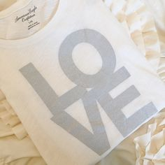 American Eagle Glitter Love Graphic T-Shirt ✨ American Eagle LOVE T-Shirt✨  • Brand new with tags • Size Large • Cream top with glitter graphic • Short sleeves  • T-Shirt  Closet Policies  ❌ No Trades  ❌ No ️️  ❤️Discounted bundles available! Xo   Please make all offers through the offer button  American Eagle Outfitters Tops Tees - Short Sleeve