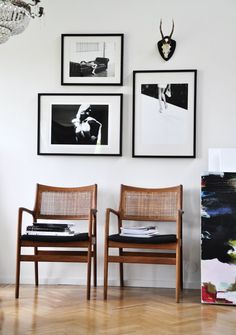 This arrangement of 3 black & white photos on a white wall is clean, crisp and elegant in its simple design.