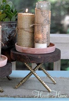 Add these DIY Burlap Candles to your fall home decor! With a shimmery gold finish, they look lovely displayed well into the holidays.