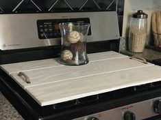 Hand-made Wood Stove Cover with Handles. Perhaps youre short on counter space? Maybe your burners are less than sparkly clean ALL the time... Is your kitchen store or travel trailer stove in need of a beautiful wood cover for when its not in use? Three size options: Standard