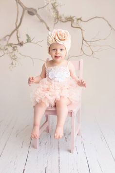 Easter mini session studio portrait; pink tutu dress and flower hat; tree branches, flowers and birds nests; spring theme   Photo by Massart Photography of Warwick, RI. www.massartphotography.com; info@massartphotography.com