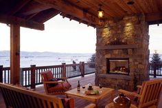 Covered deck with fireplace and shelf