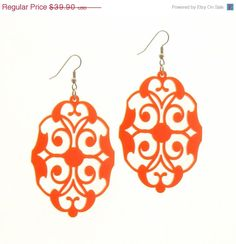 Baronyka Long Orange Floral Earrings - Party Jewelry - Bridesmade Jewelry - Modern Jewelry  These beautiful unique laser-cut earrings are made from orange acrylic, they hang on NICKEL FREE Gunmetal plated over brass earwires and measure 2.85 inches tall.  These earrings are lightweight yet substantial.  All of my jewelry comes with a gift box.   $39.9