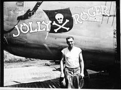"""Master Sergeant is shown standing beside a Liberator bomber called """"The Jolly Roger."""" It is a veteran of many raids on Japanese-held territory. Guadalcanal - April 10, 1944"""