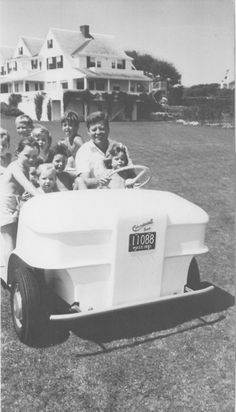 President Jack Kennedy zoomed many of the Kennedy kids all around the Kennedy compound in this golf cart, Hyannis Port, Mass.