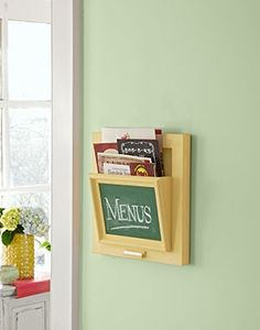 Ordering out at the end of a busy day can be a major time-saver. Having to rifle through a messy menu drawer, not so much. A handsome way to tackle the clutter: Craft a wall-mount menu holder like the one here. For step-by-steps, click here.