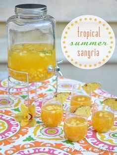 Tropical summer sangria - pineapple, mango, Pinot grigio, peach nectar. I added a cup or two of peach triple sec. This was delicious! Must use fresh fruit.