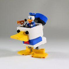 Donald Duck Mech Pilot http://www.brothers-brick.com/2016/05/22/donald-duck-mech-pilot/