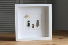 Family fun time Here is another design of a family moment with a young couple with their first little baby. Perfect gift for a new born baby, birthday or mothers day. All creation are made with pebbles, stones, shells, sea glass or branches from beaches around Edinburgh. I can