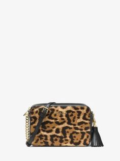 This Ginny crossbody is a standout take on a perennial necessity, thanks to its lightly structured and compact design rendered in leopard-print calf hair. Finished with chain-link accents and an oversized tassel, this everyday favorite is an easy way to elevate any outfit.