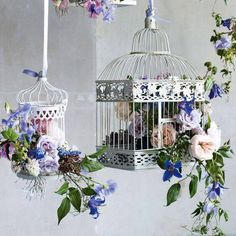 'Hang birdcages with pretty flowers and blooms at different heights for a rustic look. It would make a great wedding decor - or even a colourful summer brunch decor.  We think this idea is innovative and pretty, what about you?  (Image via Pinterest)'