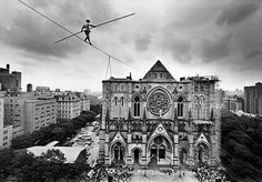 Philippe Petit on a tightrope to Cathedral of St. John the Divine. Photo: Fred R. Conrad/NYT