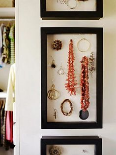 modern framed jewellery display. Since most of my jewelery never gets worn, might as well use it as bedroom art.