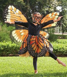 monarch butterfly girls costume - Only at Chasing Fireflies - Monarchs must love Halloween -- they always wear orange and black! This glorious costume starts as a sparkly stretch velvet and tulle dress with organza print overlay. Girls Butterfly Costume, Monarch Butterfly Costume, Butterfly Kids, Butterfly Mask, Butterfly Party, Halloween Kostüm, Halloween Costumes For Kids, Chasing Fireflies, Holiday Costumes