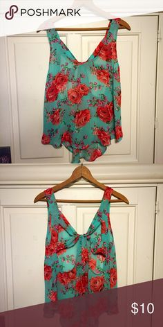 Rose and flowered blouse This Blouse is in great condition. The blouse is very sheer and thin. The shirt is very flattering and flowly. Dress this blouse up with some white pants and some wedges to make the perfect outfit. 🌹🌹 Tracie L Tops Blouses