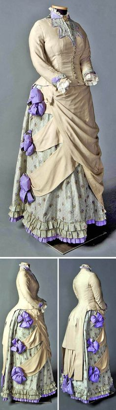 "Two-piece day ensemble in beige, pale green, & purple, North American, ca. 1882-85. Cotton, wool, silk. Fawn wool bodice cut in ""tailor-made"" style, tightly fitted with center front button closure, long cuffed sleeves, & elaborate tail, to suggest man's tailcoat. These details contrast with lace trim at collar & cuffs, 3 large purple bows on wool swags, & 3 rows of narrow box pleats around skirt hem. Foundation skirt of watered silk taffeta, worn over cage bustle. Smith College Historic…"