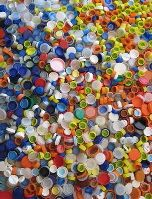 Gift your bottle caps? Well, if you just don't have time to craft them into cool things and can't recycle your caps in your area, you could always send them to Caps Can Do. They'll make new products out of them.