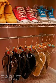 Sick of piles of shoes on the bottom of your closet? Create shoe hangers. Short tutorial here.