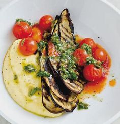Charred anchovy and tomato brinjal chips on creamy polenta